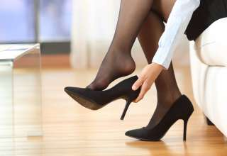 Businesswoman high heels shoes after work at home