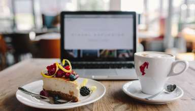 Working-in-a-restaurant-Macbook-Cheese-Cake-and-Cup-of-Coffee