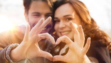 Close-up of couple making heart shape with hands Wallpaper