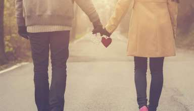 Couple in love holding hearts Wallpaper