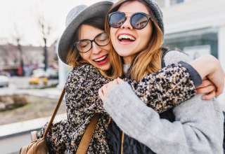 Happy brightful positive moments of two stylish girls Wallpaper