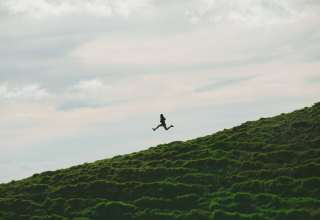 Man Jump Minimalism Sky Grass Wallpaper