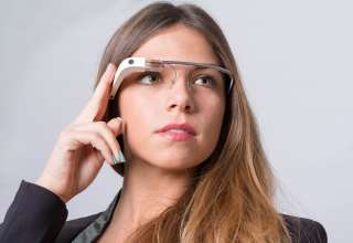 A woman wearing Google Glass Wallpaper