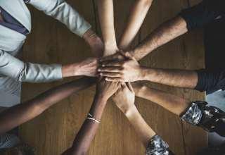 Human hands together holding together