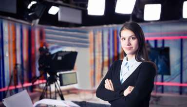 News writing and reporting.Woman journalist in television studio
