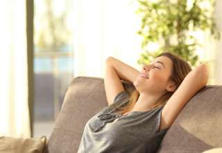 Portrait of a girl relaxing on a sofa after work at home