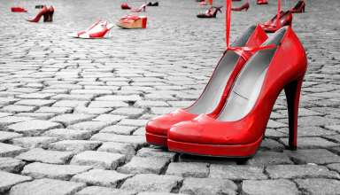 Red shoes to stop violence against women on a city square