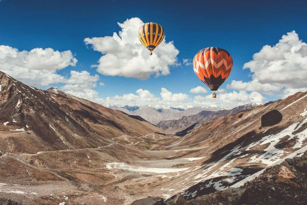 Balloons Sky Clouds Mountains Wallpaper