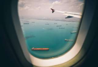 Boats Sea View From Airplane Window Wallpaper