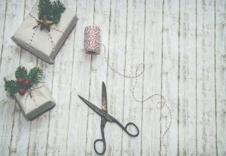 Two Gray and Green Christmas Themed Gift Boxes Wallpaper