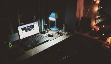 Black Laptop Beside Black Computer Mouse Inside Room Wallpaper
