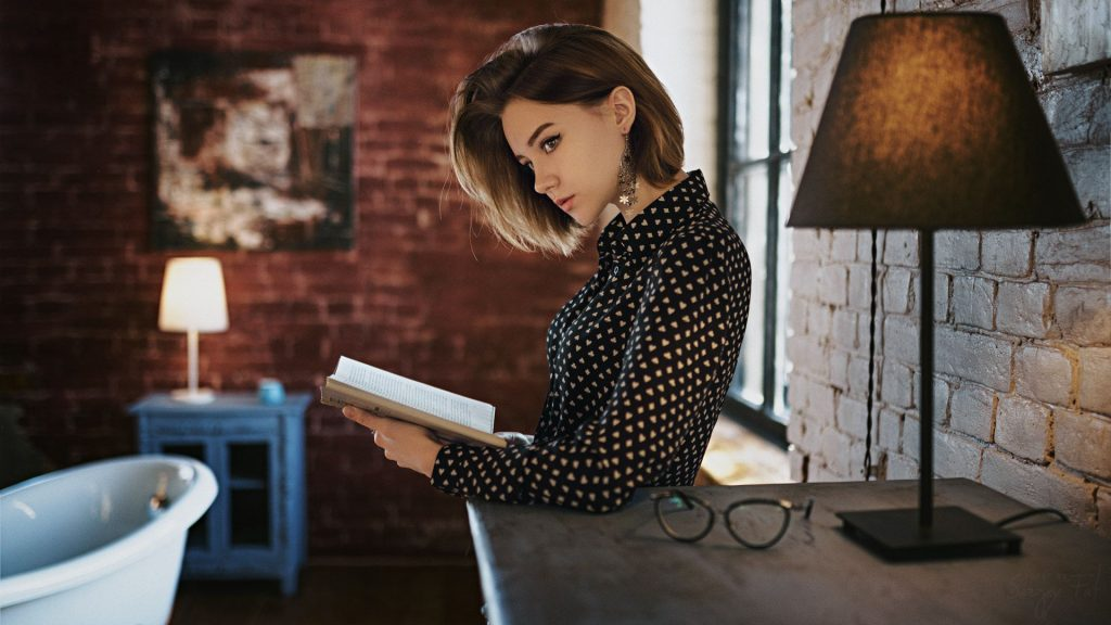 Gorgeous Girl With Book Looking Away Wallpaper