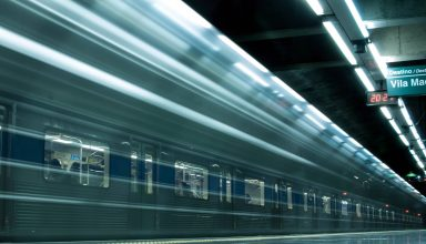 Time Lapse Photography of Train in Train Station Wallpaper