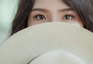 White Hat in Woman Face Wallpaper