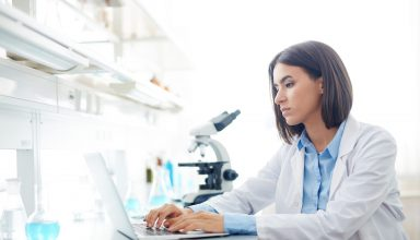 Woman Working in lab Wallpaper