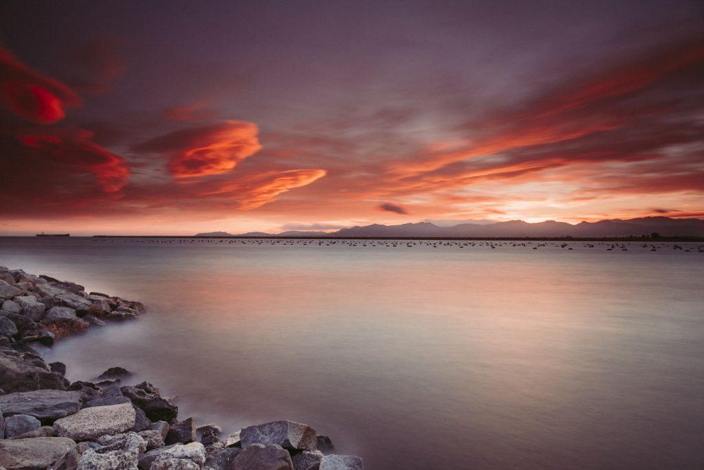 Rocks Near Body of Water During Sunset Wallpaper
