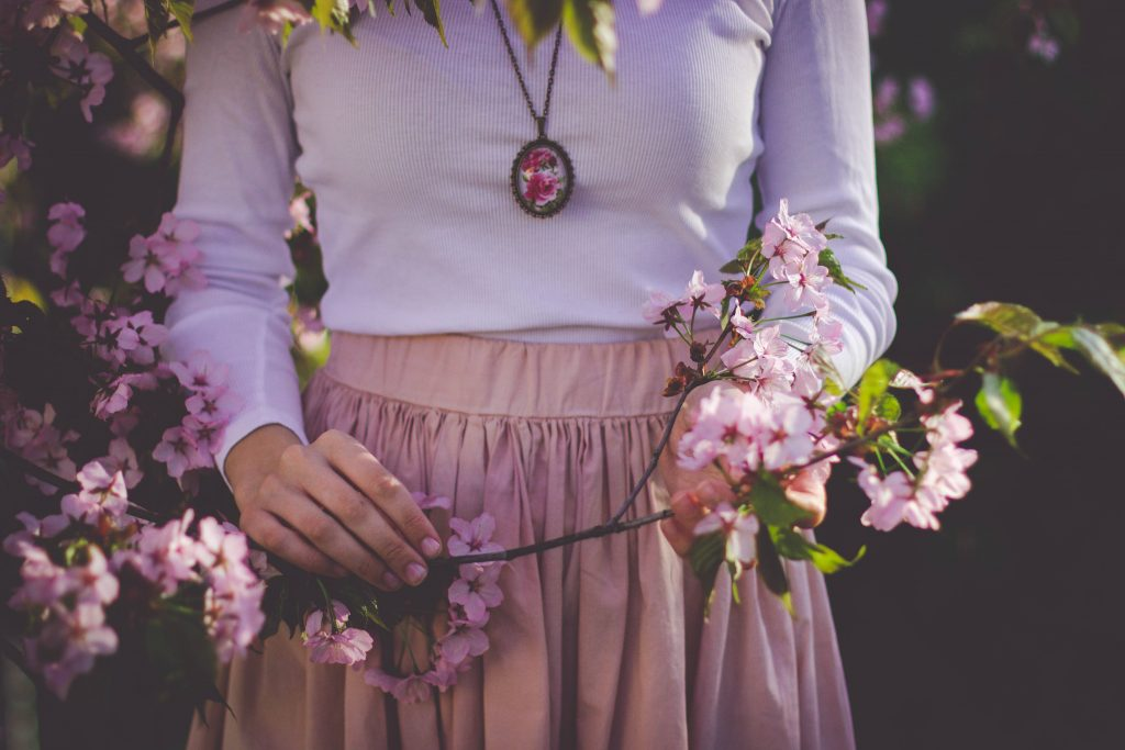Woman White Shirt and Holding Pink Flower