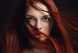 Redhead Girl Hairs on Face Wallpaper
