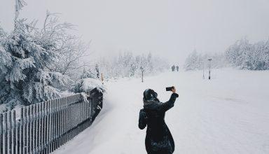 Woman in Snow Field Wallpaper