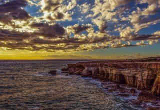 Cliff Sea Shore Stones Sky Wallpaper