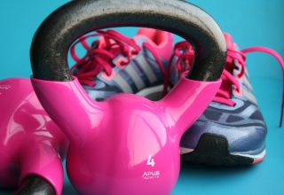 Kettle Bell Beside Adidas Pair of Shoes Wallpaper