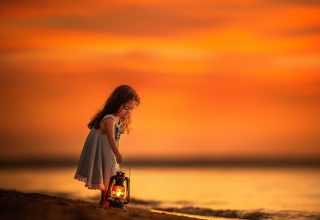 Little Girl on Beach Near Shutdown With Her Lantern Wallpaper