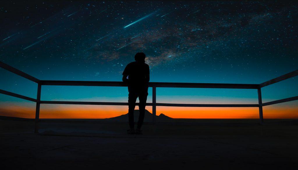 Person Silhouette Meteors Night Sky Wallpaper