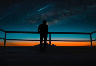 Person Silhouette Meteors Night Sky Wallpaper