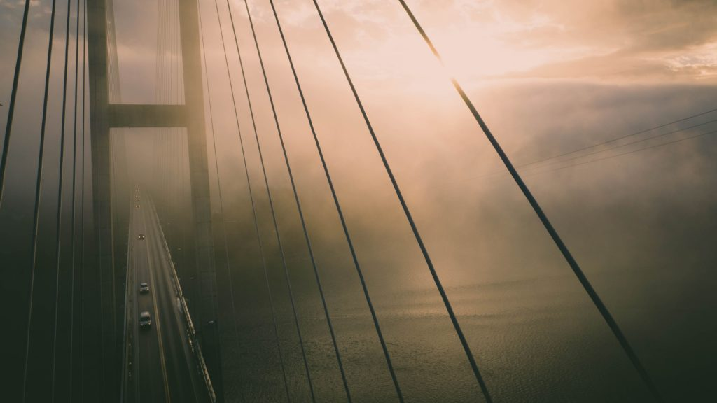 Aerial View of Bridge Misty Water Wallpaper
