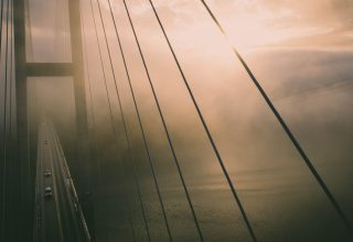 Aerial View of Bridge Misty Water Wallpaper