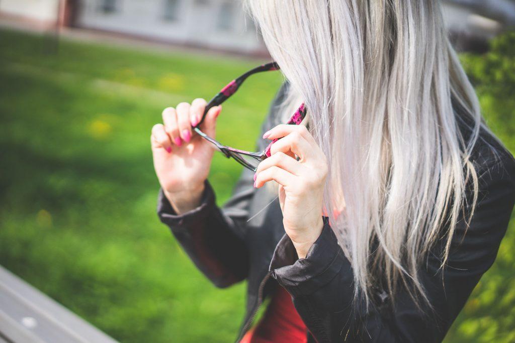 Young Blonde Woman With Fashion Eyewear Wallpaper